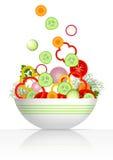 Cuvette et légumes frais Photos stock