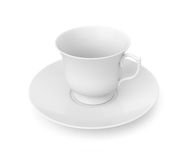 Cuvette et soucoupe de thé sur le blanc Photographie stock libre de droits
