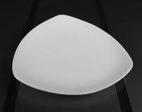 Cuvette peu profonde triangulaire de porcelaine Photographie stock
