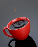 Cuvette rouge de Coffe Photographie stock libre de droits