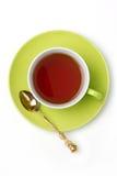 Cuvette verte de thé d'isolement sur le blanc Photographie stock libre de droits