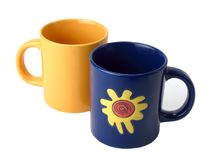 Cuvettes de thé jaunes et bleues Images libres de droits