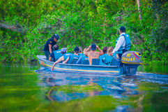 CUYABENO, ECUADOR - NOVEMBER 16, 2016: Unidentified people travelling by boat into the depth of Amazon Jungle in Stock Photography