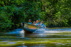 CUYABENO, ECUADOR - NOVEMBER 16, 2016: Unidentified people travelling by boat into the depth of Amazon Jungle in Royalty Free Stock Image