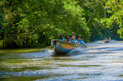 CUYABENO, ECUADOR - NOVEMBER 16, 2016: Unidentified people travelling by boat into the depth of Amazon Jungle in Stock Photo