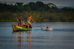 CUYABENO, ECUADOR - NOVEMBER 16, 2016: Young Tourists Jumping Into The Lagoon Grande Against The Sunset, Cuyabeno Stock Photos