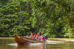Biologists In The Canoe Crossing Cuyabeno River royalty free stock photo