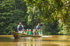 Biologists Exploring The Marvels Of  Amazon Jungle. Cuyabeno, Ecuador - 20 March 2015: European Biologists Exploring The Marvels Of The Amazon Jungle Crossing Royalty Free Stock Image
