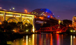 Cuyahoga bridges. The Detroit-Superior and Center Street bridges over the Cuyahoga River in Cleveland, lit up in festive colors at dusk Stock Image