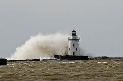 Lighthouse in a fall storm. Royalty Free Stock Image