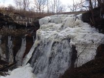 Cuyahoga Valley Brandywine Falls. The Brandywine Falls waterfall at Cuyahoga Valley National Park, partially frozen in January Stock Photography