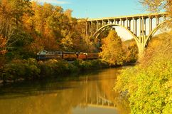 Cuyahoga Valley Scenic Railroad train under bridge overpass Royalty Free Stock Photos