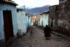 Cuzco. Woman walking on street in Cuzco stock photos