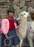 Cuzco - Peru. Local woman with alpaca at Hatumrumiyoc Inca Wall in Cuzco in Peru stock photos