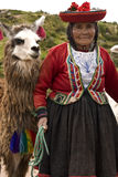 Cuzco in Peru. Elderly local woman with her Alpaca near Cuzco in Peru stock photos