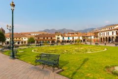Parade Ground garden and historic buildings of Cuzco at sunset stock photos