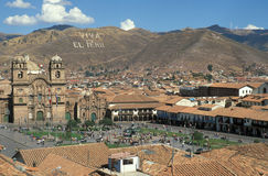 Cuzco Town Square. Old buildings and a church surrounding the town square (Plaza de Armas) of Cuzco, Peru stock photo