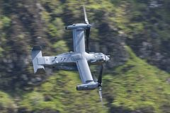CV-22 Osprey flying through the Mack Loop. US Air Force CV-22 Osprey flying through the Mack Loop in North Wales stock image