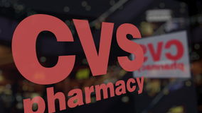 CVS Health logo on the glass against blurred business center. Editorial 3D rendering Stock Photography