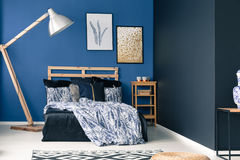 Cyan bedroom with wooden furniture. Cyan bedroom interior with wooden furniture and decorative rug royalty free stock photos
