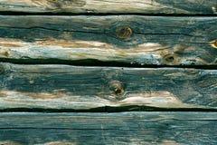 Cyan-blaue getonte Blockhauswand Stockbilder