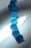 Cyan-blaue Pillen Lizenzfreie Stockbilder