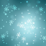 Cyan blue abstract snowflake and star shapes bokeh background Stock Photo