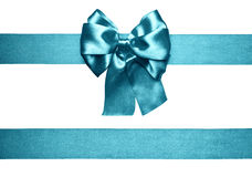 Cyan bow and ribbon from silk. Cyan bow and ribbon made from silk royalty free stock image