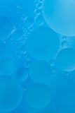 Cyan bubble background. Cyan bubble created by oil as background stock image