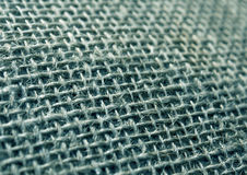 Cyan color hessian cloth sack texture with blur effect. Royalty Free Stock Photo