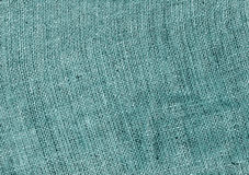 Cyan color hessian sack cloth texture. Royalty Free Stock Photography