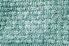 Cyan color knitted pattern. Abstract background and texture Stock Photography