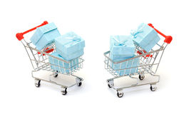 Cyan gift boxes in shopping carts Stock Photography
