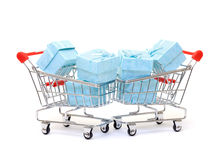 Cyan gift boxes in shopping carts Stock Images