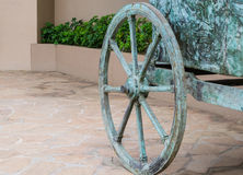 Cyan horse chariot wheel. Yard decor with a horse chariot wheel Royalty Free Stock Image