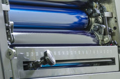 Cyan ink color rollers of a offset color printing press., close up Stock Image