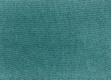 Cyan knitted material texture. Royalty Free Stock Image