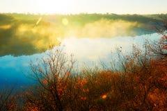 The cyan lake and golden sunshine Stock Photography