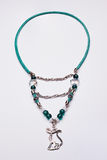 Cyan long necklace with a cat pendant Royalty Free Stock Image