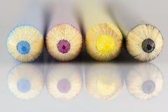 Cyan Magenta Yellow Black pencils macro shot. Colored pencils close up - CMYK pencils close up front view Stock Photography