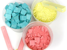 Cyan, magenta and yellow crushed chalk. In plastic caps on white Stock Photography