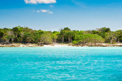 Cyan ocean before beach with sand Stock Photos