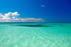 Cyan ocean under blue sky with clouds. In summer Royalty Free Stock Images