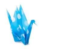 Cyan origami crane. Semi-transparent cyan paper crane on white background. Very shallow depth of field Stock Photography