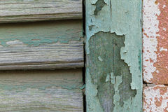 Cyan peeling paint window wood planks and pink brick wall Stock Photos
