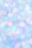Cyan and Purple Glittery Background Texture. Dynamic, shiny colorful (blue and purple) glitter bokeh background texture stock images