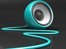 Cyan speaker with cable over grey Stock Photography