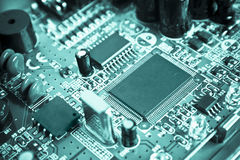 Cyan technological circuit. Cyan technological modern circuit with integrated circuits , capacitors, quartz stock image