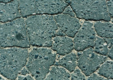 Cyan toned damaged asphalt road texture. Royalty Free Stock Images