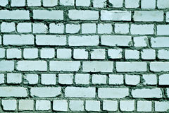 Cyan toned rough brick wall pattern. Stock Photo